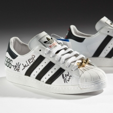 <p>adidas x Run–DMC. 25th Anniversary Superstar, 2011. Courtesy of Run–DMC, collection of Erik Blam. (Photo: Ron Wood. Courtesy American Federation of Arts/Bata Shoe Museum)</p>