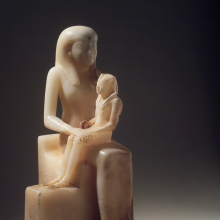<p><em>Statuette of Queen Ankhnes-meryre II and Her Son, Pepy II</em>. Egypt, probably from Upper Egypt. Old Kingdom, Dynasty 6, reign of Pepy II, circa 2288–2224/2194 <small>B.C.E.</small> Egyptian alabaster, 15<sup>7</sup>⁄<sub>16</sub> x 9<sup>13</sup>⁄<sub>16</sub> in. (39.2 × 24.9 cm). Brooklyn Museum, Charles Edwin Wilbour Fund, 39.119</p>
