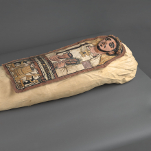 <p><em>Cartonnage and Mummy of an Anonymous Man</em>. Egypt, excavated in Deir el Bahri. Roman Period, 3rd century <small>C.E.</small> Linen, plaster, paint, organic materials; cartonnage: 13<sup>1</sup>&frasl;<sub>4</sub> x 35<sup>7</sup>&frasl;<sub>16</sub> in. (33.7 &times; 90 cm); mummy, approximately: 8 &times; 20 &times; 62 in. (20.3 &times; 50.8 &times; 157.5 cm). Brooklyn Museum, Charles Edwin Wilbour Fund, 52.128a&ndash;e</p>