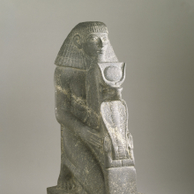 <p><em>Kneeling Statue of Senenmut</em>. Egypt, from Armant. New Kingdom, Dynasty 18, joint reign of Hatshepsut and Thutmose III, 1478–1458 <small>B.C.E.</small> Granite, 18<sup>9</sup>⁄<sub>16</sub> x 6<sup>7</sup>⁄<sub>8</sub> in. (47.2 × 17.4 cm), base: 6<sup>3</sup>⁄<sub>4</sub> x 2<sup>15</sup>⁄<sub>16 </sub>x 11<sup>9</sup>⁄<sub>16</sub> in. (17.2 × 7.5 × 29.3 cm). Brooklyn Museum, Charles Edwin Wilbour Fund, 67.68</p>