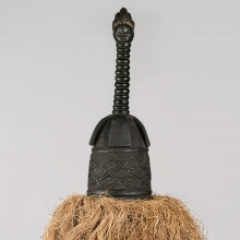 <p>Unidentified Gola artist. <em>Helmet Mask (Gbetu) with Raffia Costume</em>, early to mid-20th century. Grand Cape Mount or Lofa County, Liberia. Wood, pigment, metal, raffia, 93 x 48 in. (236.2 x 121.9 cm). Brooklyn Museum, Gift of William C. Siegmann, 2011.53.1a, b. Creative Commons-BY. Photo: Sarah DeSantis, Brooklyn Museum</p>