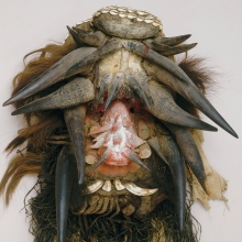 <p>Unidentified We artist. <em>Mask (Gela)</em>, Liberia or Côte d'Ivoire. Wood, raffia, cloth, teeth, horn, feathers, hair, fiber cord, cowrie shells, mud, and pigment, 31<sup>7</sup>⁄<sub>8</sub> x 18 x 11 in. (81 x 45.7 x 28.8 cm). Seattle Art Museum, Gift of Katherine White and the Boeing Company, 81.17.193</p>
