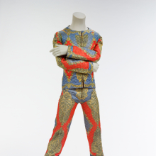 <p>Quilted two-piece suit, 1972. Designed by Freddie Burretti for the <em>Ziggy Stardust</em> tour. Courtesy of The David Bowie Archive. Image © Victoria and Albert Museum</p>