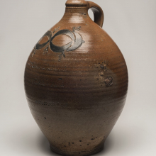 <p>Thomas W. Commeraw (American, active first quarter 19th century). <em>Jug</em>, early 19th century. Glazed stoneware, Gift of Arthur W. Clement, 43.128.12</p>