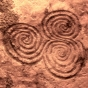 <p><em>Tri-spiral Design</em>, also known as <em>Three-spiral Stone</em>. Newgrange, County Meath, Ireland, circa 3000 <small>B.C.E.</small></p>  <p>(Image: Knowth Web site.)</p>