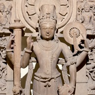 <p><i>Vishnu Flanked by His Personified Attributes</i>. Northern or central India, 12th century. Sandstone, 40<sup>1</sup>&frasl;<sub>2</sub> x 22<sup>5</sup>&frasl;<sub>8</sub> x 8 in. (103 &times; 57.7 &times; 20.3 cm). Krannert Art Museum and Kinkead Pavilion, University of Illinois, Urbana-Champaign, Gift of Ellnora D. Krannert, 1969-10-1</p>