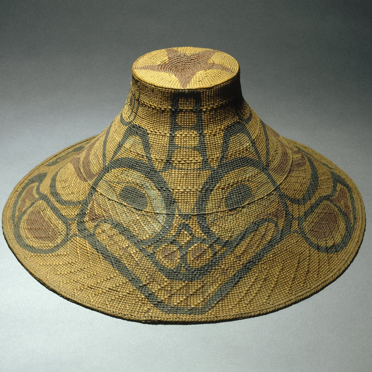<p><i>Hat with Tcamaos Design</i>, late 19th century. Tom Price, Haida artist (circa 1860–1927). Skidegate, Queen Charlotte Islands, British Columbia, Canada. Spruce root, pigment. Brooklyn Museum, Museum Expedition 1905, Museum Collection Fund, 05.588.7322</p>
