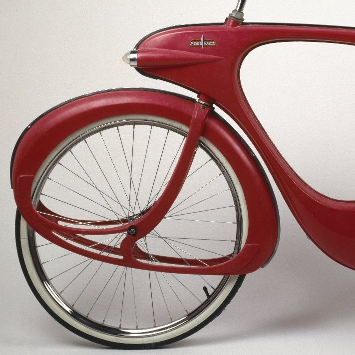 <p>Benjamin J. Bowden (American, born England, 1907&ndash;1998). <i>Spacelander Bicycle</i>, designed 1946, manufactured circa 1960. Made by Bomard Industries, Grand Haven, Michigan. Fiberglass, metal, glass, rubber, 36 &times; 40 &times; 18 in. (91.4 &times; 101.6 &times; 45.7 cm). Brooklyn Museum, Marie Bernice Bitzer Fund, 2001.36</p>