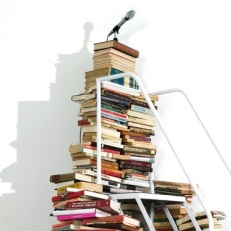 <p>Satch Hoyt (b. United Kingdom 1957; works in United States). <em>Say It Loud!</em>, 2004. Five hundred books, white metal staircase, and microphone with four speakers, wall text; dimensions variable. Courtesy of the artist</p>