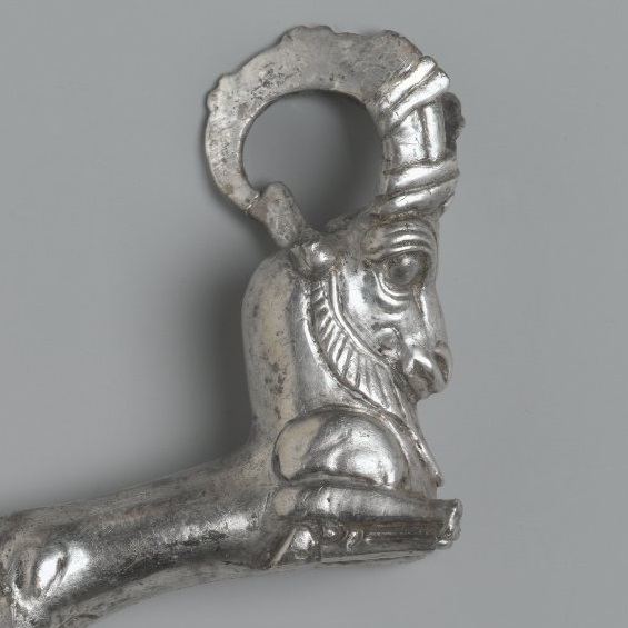 <p><i>Vessel Handle in Form of Ibex</i>. Found in Tell el-Maskhuta, Egypt; possibly from Iran. Achaemenid Period, late 5th century <small>B.C.E.</small> Silver, height: 6<sup>9</sup>&frasl;<sub>16</sub> in. (16.7cm). Brooklyn Museum, Charles Edwin Wilbour Fund, 54.50.41</p>