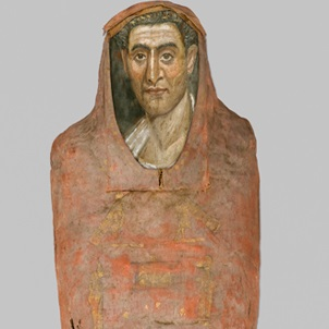 <p><i>Mummy of Demetrios</i>. Egypt, from Hawara. Roman Period. 95&minus;100 <small>C.E.</small> Painted cloth, gold, human remains, wood, encaustic, gilding, 13<sup>3</sup>&frasl;<sub>8</sub> x 15<sup>3</sup>&frasl;<sub>8</sub> x 74<sup>13</sup>&frasl;<sub>16</sub> in (34 &times; 39 &times; 190 cm), portrait: 14 11/16 &times; 8 1/16 &times; 1/16 in. (37.3 &times; 20.5 &times; 0.2 cm). Brooklyn Museum, Charles Edwin Wilbour Fund, 11.600a&minus;b</p>