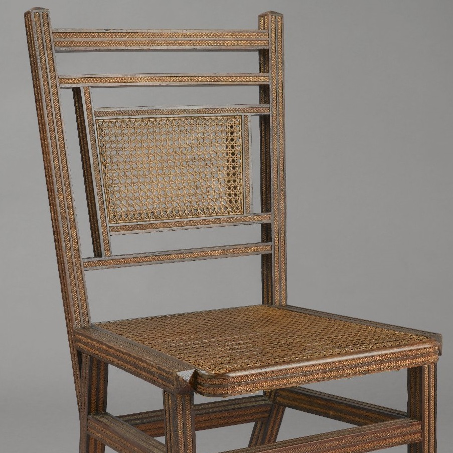 <p>George Jacob Hunzinger (American, born Germany, 1835&ndash;1898). <i>Side Chair</i>, Patented March 13, 1883. Wood, cane, straw braid, 35<sup>3</sup>&frasl;<sub>8</sub> x 17<sup>1</sup>&frasl;<sub>2</sub> x 20<sup>3</sup>&frasl;<sub>8</sub> in. (89.9 &times; 44.5 &times; 51.8 cm). Brooklyn Museum, Designated Purchase Fund, 2011.13</p>