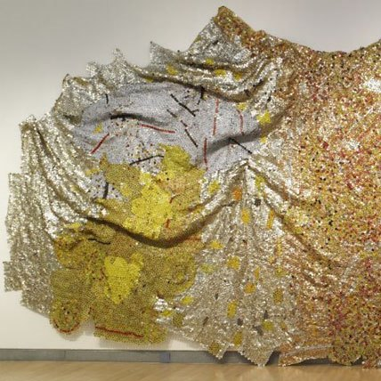 <p>El Anatsui (Ghanaian, b. 1944). <i>Gravity and Grace</i>, 2010. Aluminum and copper wire, 145<sup>5</sup>⁄<sub>8</sub> x 441 in. (369.9 &#215; 1120.1 cm). Courtesy of the artist and Jack Shainman Gallery, New York. Brooklyn Museum photograph</p>