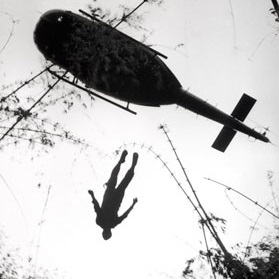 <p>Henri Huet (French, 1927&ndash;1971). <em>The body of an American paratrooper killed in action in the jungle near the Cambodian border is raised up to an evacuation helicopter, Vietnam</em>, 1966. Gelatin silver print (printed 2004), 14 &times; 10<sup>7</sup>&frasl;<sub>8</sub> in. (35.6 &times; 27.7 cm). The Museum of Fine Arts, Houston, museum purchase. &copy; Associated Press</p>