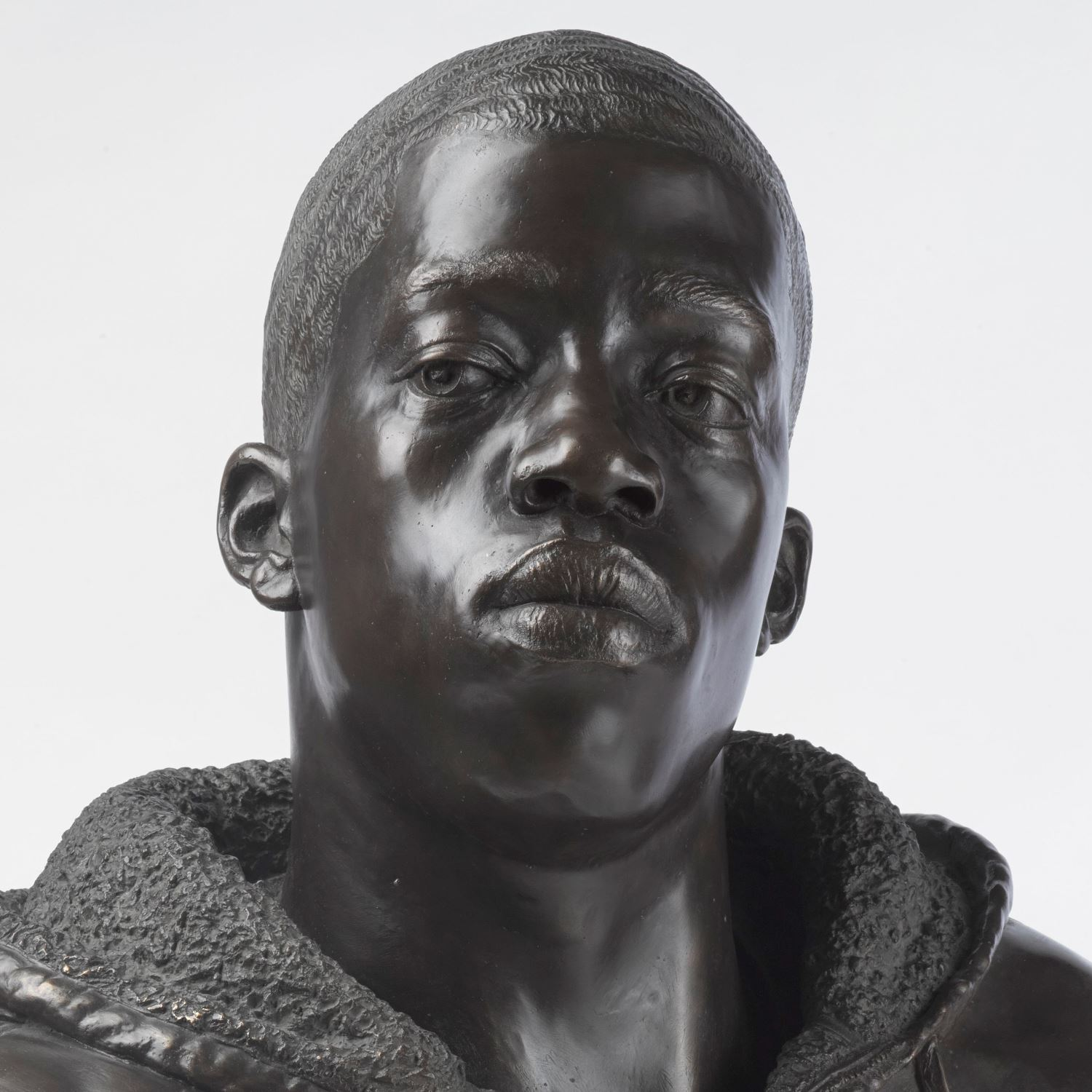 <p>Kehinde Wiley (American, b. 1977). <em>Houdon Paul-Louis</em>, 2011. Bronze with polished stone base, 34 &times; 26 &times; 19 in. (86.4 &times; 66 &times; 48.3 cm). Brooklyn Museum; Frank L. Babbott Fund and A. Augustus Healy Fund, 2012.51. &copy; Kehinde Wiley. (Photo: Sarah DeSantis, Brooklyn Museum)</p>