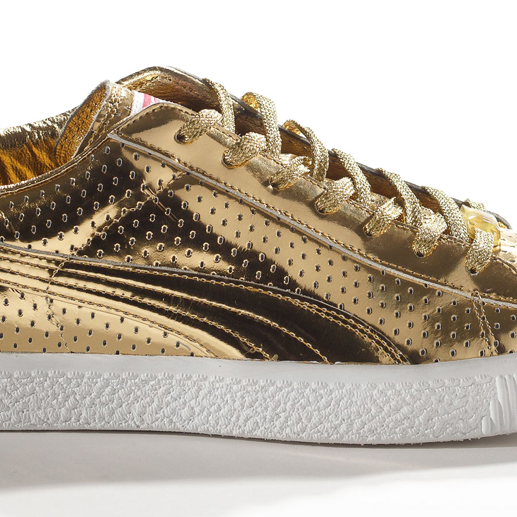 <p>PUMA x Undefeated. Clyde Gametime Gold, 2012. PUMA Archives. (Photo: Ron</p>  <p>Wood. Courtesy American Federation of Arts/Bata Shoe Museum)</p>