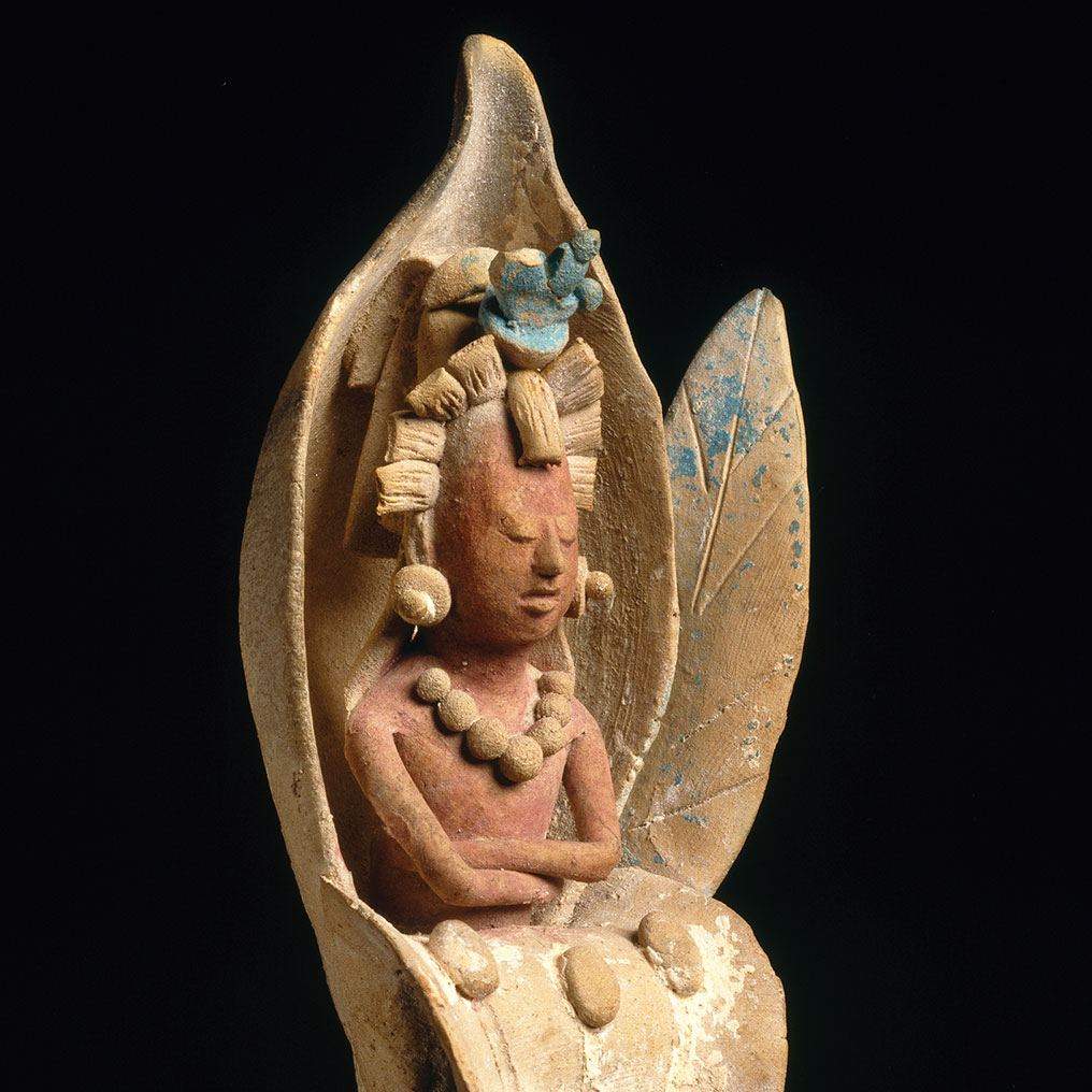 <p>Maya.<em> Figure Emerging from a Water Lily</em>, 600&ndash;900. Ceramic, pigment, 8<sup>1</sup>/<sub>4</sub> x 2<sup>1</sup>/<sub>8</sub> x 1<sup>11</sup>/<sub>16</sub> in. (21 x 5.4 x 4.3 cm). Brooklyn Museum, Dick S. Ramsay Fund, 70.31</p>