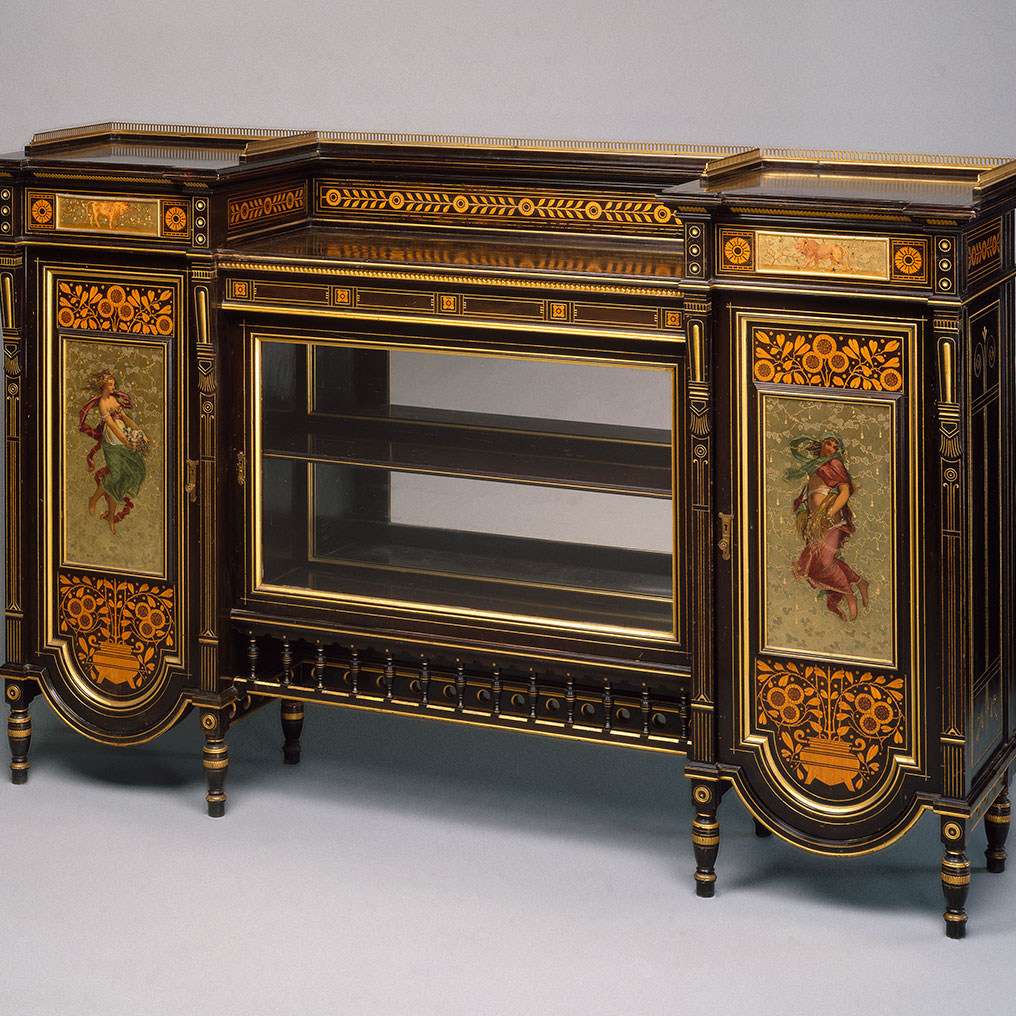 <p>Herter Brothers (American, 1865&ndash;1905). <em>Cabinet</em>, late 1870s. Ebonized cherry, other woods, glass, brass, pigment, 42<sup>3</sup>/<sub>8</sub> x 66 x 16<sup>3</sup>/<sub>4</sub> in. (107.6 x 167.6 x 42.5cm). Brooklyn Museum, H. Randolph Lever Fund, 76.63a&ndash;f</p>