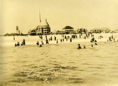 """<em>""""Beach Haven: the great seashore opportunity. Views of Beach Haven. View 48: beach view, showing bathers, Engleside Hotel and water tower.""""</em>, 1900-1914. Bw photograph (original print), 9 x 7in (23 x 18cm). Brooklyn Museum, Beachhaven. (F142_O2_B35_Beachhaven_046.jpg"""