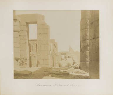 "<em>""Ramesseum: Statue and Temple""</em>. Printed material. Brooklyn Museum. (Photo: Brooklyn Museum, N376_B14_Beato_vol1_pl10_PS4.jpg"