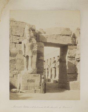 "<em>""Karnak: Statue and Entrance to the Temple of Ramses""</em>. Printed material. Brooklyn Museum. (Photo: Brooklyn Museum, N376_B14_Beato_vol2_pl01_PS4.jpg"