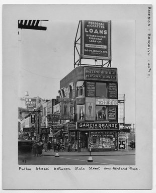 "<em>""Fulton Street between State Street and Ashland Place.""</em>. Bw photograph, 9.5 x 7.5in (24.1 x 19.1cm). Brooklyn Museum, CHART_2012. (NA202_C68_box2_Fulton_Street.jpg"