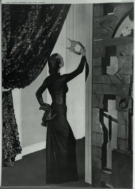 """<em>""""Left, against a cabinet by Eugene Berman, Alix's dinner dress of black silk jersey with a shirred taffeta corselet and a bow that holds all the fullness in back. Model: Alix.""""</em>, 1939. Bw negative 4x5in. Brooklyn Museum. (Photo: Brooklyn Museum, PER_Harpers_Bazaar_1939_09_01_p66_Alix_Salon_Moderne.jpg"""