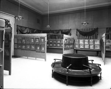"""<em>""""Brooklyn Museum building: interior. View: Painting and Sculpture: Tissot Gallery [02], n.d. Paintings with circular bench in foreground. Floor: 5.""""</em>. Glass negative 8x10in, 8 x 10 in. Brooklyn Museum, CHART_2013. (Photo: Brooklyn Museum, PHO_INT_VIEW_PSC_Tissot_Gallery_02_001_glass_bw.jpg"""
