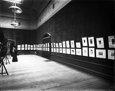 """<em>""""Brooklyn Museum building: interior. View: Painting and Sculpture: Tissot Gallery [03], n.d. Female patron viewing paintings. Floor: 5.""""</em>. Glass negative 8x10in, 8 x 10 in. Brooklyn Museum, CHART_2013. (Photo: Brooklyn Museum, PHO_INT_VIEW_PSC_Tissot_Gallery_03_001_glass_bw.jpg"""
