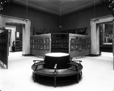 """<em>""""Brooklyn Museum building: interior. View: Painting and Sculpture: Tissot Gallery [04], n.d. Paintings with circular bench in foreground. Floor: 5.""""</em>. Glass negative 8x10in, 8 x 10 in. Brooklyn Museum, CHART_2013. (Photo: Brooklyn Museum, PHO_INT_VIEW_PSC_Tissot_Gallery_04_001_glass_bw.jpg"""