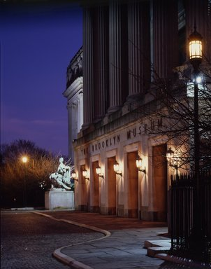 "<em>""Brooklyn Museum: exterior. View of the Central section portico from the west at twilight, showing lit entrance lamps, n.d. (ca. 1971-1988).""</em>, 1971. Color transparency 4x5in, 4 x 5in (10.2 x 12.7 cm). Brooklyn Museum, Museum building. (Photo: Brooklyn Museum, S06_BEEi085.jpg"