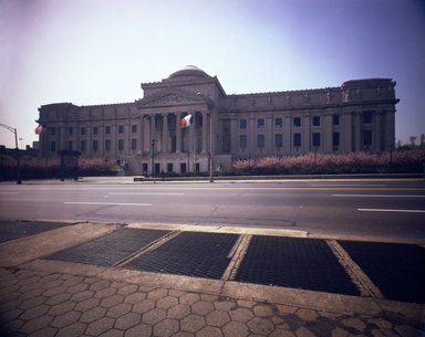 "<em>""Brooklyn Museum: exterior. View of the Eastern Parkway façade from the north, showing cherry blossoms and Eastern Parkway in the foreground, 1983.""</em>, 1983. Color negative 4x5in, 4 x 5in (10.2 x 12.7 cm). Brooklyn Museum, Museum building. (Photo: Brooklyn Museum, S06_BEEi107.jpg"