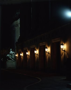 "<em>""Brooklyn Museum: exterior. View of the Central section entrance at night from the entrance pathway, showing lit lamps and Manhattan statue in the background, 1990.""</em>, 1990. Color transparency 4x5in, 4 x 5in (10.2 x 12.7 cm). Brooklyn Museum, Museum building. (Photo: Brooklyn Museum, S06_BEEi141.jpg"