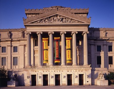 "<em>""Brooklyn Museum: exterior. View of the Central section from the north, showing Gottlieb, Arts of Africa and Bearden banners, 1995.""</em>, 1995. Color transparency 4x5in, 4 x 5in (10.2 x 12.7 cm). Brooklyn Museum, Museum building. (Photo: Brooklyn Museum, S06_BEEi145.jpg"