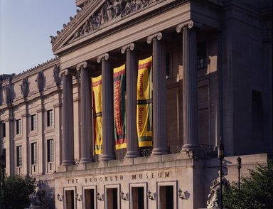 "<em>""Brooklyn Museum: exterior. View of the Central section from the northwest, showing Gottlieb, Arts of Africa and Bearden banners, 1995.""</em>, 1995. Color transparency 4x5in, 4 x 5in (10.2 x 12.7 cm). Brooklyn Museum, Museum building. (Photo: Brooklyn Museum, S06_BEEi146.jpg"