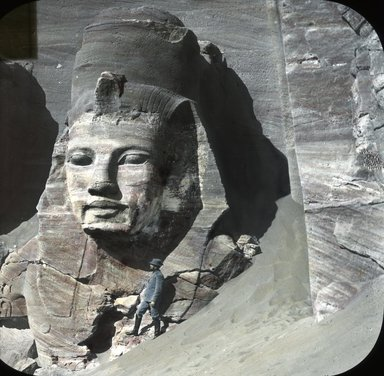 "<em>""Views, Objects: Egypt. Abu Simbel. View 02: Egypt. Abu Simbel. Colossus No. 4. 19 Dyn?""</em>. Lantern slide 3.25x4in, 3.25 x 4 in. Brooklyn Museum, lantern slides. (S10_08_Egypt_AbuSimbel02.jpg"