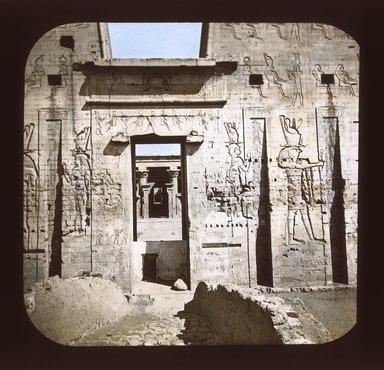 """<em>""""Views, Objects: Egypt. Edfu. View 02: Egypt - Edfu. Door of the Pylon.""""</em>. Lantern slide 3.25x4in, 3.25 x 4 in. Brooklyn Museum, lantern slides. (S10_08_Egypt_Edfu02_SL1.jpg"""