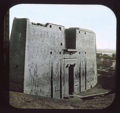 "<em>""Views, Objects: Egypt. Edfu. View 04: Egypt - Edfu. The Pylon.""</em>. Lantern slide 3.25x4in, 3.25 x 4 in. Brooklyn Museum, lantern slides. (S10_08_Egypt_Edfu04_SL1.jpg"