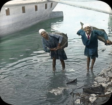 "<em>""Views, Objects: Egypt. General Views; People. View 010: Egypt - Water Carriers - Men, Cairo.""</em>. Lantern slide 3.25x4in, 3.25 x 4 in. Brooklyn Museum, lantern slides. (S10_08_Egypt_GeneralViews_People010.jpg"