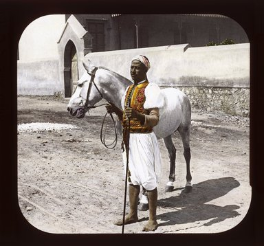 "<em>""Views, Objects: Egypt. General Views; People. View 013: Egypt - Arabian Horse and Sais, Cairo.""</em>. Lantern slide 3.25x4in, 3.25 x 4 in. Brooklyn Museum, lantern slides. (S10_08_Egypt_GeneralViews_People013_SL1.jpg"