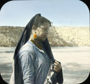 "<em>""Views, Objects: Egypt. General Views; People. View 016: Egypt - Woman, Unveiled, Cairo.""</em>. Lantern slide 3.25x4in, 3.25 x 4 in. Brooklyn Museum, lantern slides. (Photo: T. H. McAllister, New York, S10_08_Egypt_GeneralViews_People016.jpg"