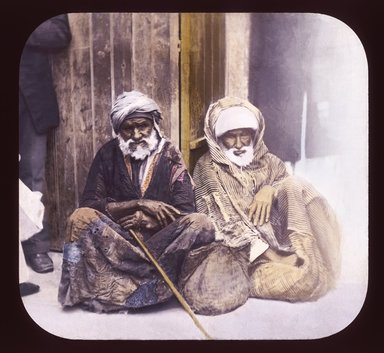 "<em>""Views, Objects: Egypt. General Views; People. View 021: Egypt - Beggars, Alexandria.""</em>. Lantern slide 3.25x4in, 3.25 x 4 in. Brooklyn Museum, lantern slides. (Photo: T. H. McAllister, New York, S10_08_Egypt_GeneralViews_People021_SL1.jpg"