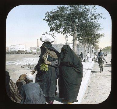 "<em>""Views, Objects: Egypt. General Views; People. View 024: Egypt - Woman, Veiled, Cairo.""</em>. Lantern slide 3.25x4in, 3.25 x 4 in. Brooklyn Museum, lantern slides. (Photo: T. H. McAllister, New York, S10_08_Egypt_GeneralViews_People024_SL1.jpg"