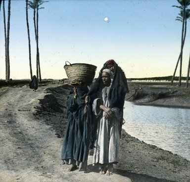 "<em>""Views, Objects: Egypt. General Views; People. View 026: Egypt - Arab with wife and child, Gizeh.""</em>. Lantern slide 3.25x4in, 3.25 x 4 in. Brooklyn Museum, lantern slides. (S10_08_Egypt_GeneralViews_People026.jpg"