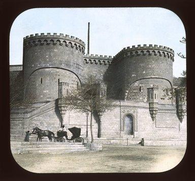 "<em>""Views, Objects: Egypt. General Views; People. View 046: Egypt - Gate at the Citadel, Cairo. 1166 Saladin.""</em>. Lantern slide 3.25x4in, 3.25 x 4 in. Brooklyn Museum, lantern slides. (Photo: T. H. McAllister, New York, S10_08_Egypt_GeneralViews_People046_SL1.jpg"