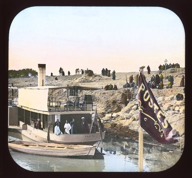 "<em>""Views, Objects: Egypt. General Views; People. View 055: Egypt - Arrival of Post Boat, Girgeh.""</em>. Lantern slide 3.25x4in, 3.25 x 4 in. Brooklyn Museum, lantern slides. (Photo: T. H. McAllister, New York, S10_08_Egypt_GeneralViews_People055_SL1.jpg"