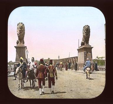 "<em>""Views, Objects: Egypt. General Views; People. View 075: Egypt - Natives on Donkeys, Kasr-en-Nil.""</em>. Lantern slide 3.25x4in, 3.25 x 4 in. Brooklyn Museum, lantern slides. (Photo: T. H. McAllister, New York, S10_08_Egypt_GeneralViews_People075_SL1.jpg"