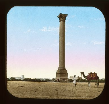 "<em>""Views, Objects: Egypt. General Views; People. View 076: Pompey's Pillar, Alexandria.""</em>. Lantern slide 3.25x4in, 3.25 x 4 in. Brooklyn Museum, lantern slides. (Photo: T. H. McAllister, New York, S10_08_Egypt_GeneralViews_People076_SL1.jpg"