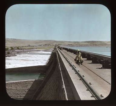 """<em>""""Views, Objects: Egypt. General Views; People. View 079: Great Nile Dam, at first cataract, Egypt.""""</em>, 1908. Lantern slide 3.25x4in, 3.25 x 4 in. Brooklyn Museum, lantern slides. (Photo: Stereo-Travel Co., Corona, New York, S10_08_Egypt_GeneralViews_People079_SL1.jpg"""