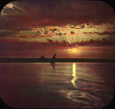 "<em>""Views, Objects: Egypt. General Views; People. View 088: Egypt - Sunset on the Nile.""</em>. Lantern slide 3.25x4in, 3.25 x 4 in. Brooklyn Museum, lantern slides. (S10_08_Egypt_GeneralViews_People088.jpg"